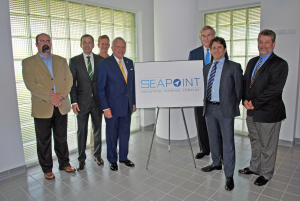 business people in front of sign for seapoint complex